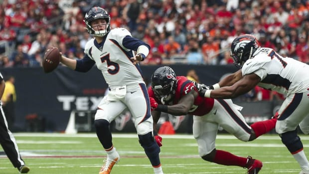 Denver Broncos quarterback Drew Lock (3) passes the ball as Houston Texans outside linebacker Whitney Mercilus (59) attempts to make a tackle during the second quarter at NRG Stadium.
