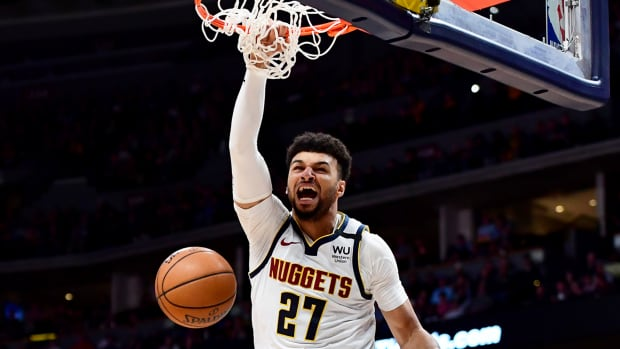 Mar 9, 2020; Denver, Colorado, USA; Denver Nuggets guard Jamal Murray (27) finishes off a basket over Milwaukee Bucks forward D.J. Wilson (5) in the third quarter at the Pepsi Center.