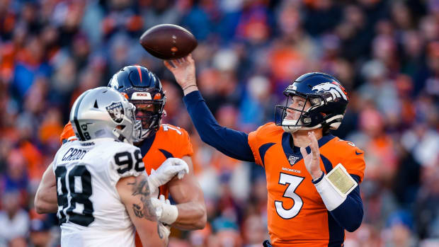 Denver Broncos quarterback Drew Lock (3) attempts a pass as offensive tackle Garett Bolles (72) defends against Oakland Raiders defensive end Maxx Crosby (98) in the first quarter at Empower Field at Mile High.