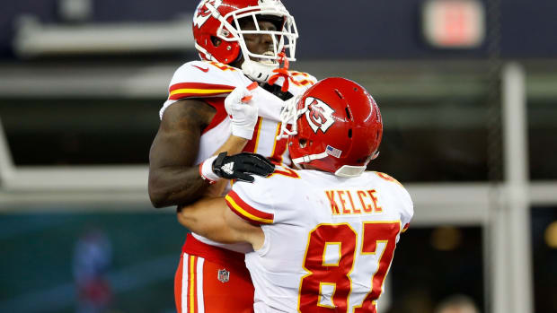 Sep 7, 2017; Foxborough, MA, USA; Kansas City Chiefs wide receiver Tyreek Hill (10) celebrates with tight end Travis Kelce (87) after scoring a touchdown against the New England Patriots at Gillette Stadium. Mandatory Credit: Greg M. Cooper-USA TODAY Sports