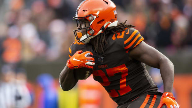 Dec 8, 2019; Cleveland, OH, USA; Cleveland Browns running back Kareem Hunt (27) runs the ball against the Cincinnati Bengals during the second quarter at FirstEnergy Stadium. Mandatory Credit: Scott R. Galvin-USA TODAY Sports