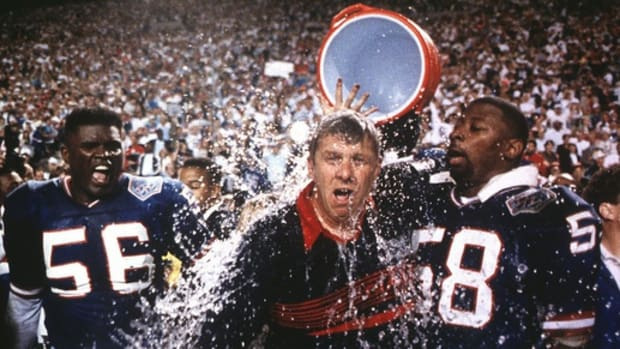 Giants head coach Bill Parcells gets doused with Gatorade with linebackers Lawrence Taylor, left, and Carl Banks, right, after the 20-19 win over the Bills in Superbowl XXV in Tampa, Fla. on Jan. 27, 1991