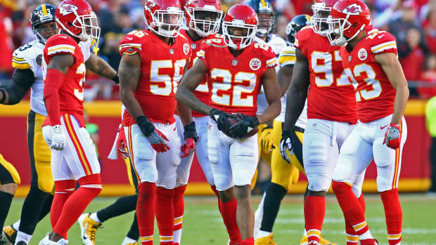 Oct 15, 2017; Kansas City, MO, USA; Kansas City Chiefs cornerback Marcus Peters (22) is congratulated by teammates after intercepting a pass against the Pittsburgh Steelers in the first half at Arrowhead Stadium. Mandatory Credit: Jay Biggerstaff-USA TODAY Sports