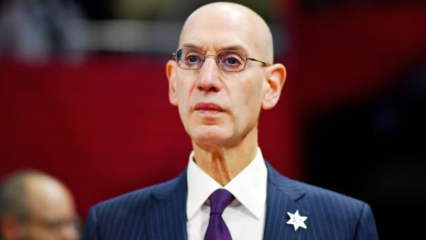 NBA Commissioner Adam Silver looks on during the NBA All Star-Celebrity Game at Wintrust Arena in Feb. 2020.