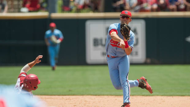 Mississippi Rebels shortstop Grae Kessinger (15) throws to first for a double play during the game against the Arkansas Razorbacks at Baum-Walker Stadium. Mandatory Credit: Brett Rojo-USA TODAY Sports