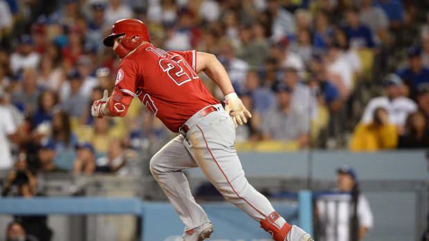 July 24, 2019; Los Angeles, CA, USA; Los Angeles Angels center fielder Mike Trout (27) hits a sacrifice RBI against the Los Angeles Dodgers during the sixth inning at Dodger Stadium. Mandatory Credit: Gary A. Vasquez-USA TODAY Sports