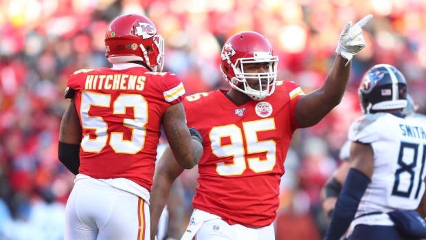 Jan 19, 2020; Kansas City, Missouri, USA; Kansas City Chiefs defensive tackle Chris Jones (95) and linebacker Anthony Hitchens (53) celebrate a play against the Tennessee Titans in the AFC Championship Game at Arrowhead Stadium. Mandatory Credit: Mark J. Rebilas-USA TODAY Sports