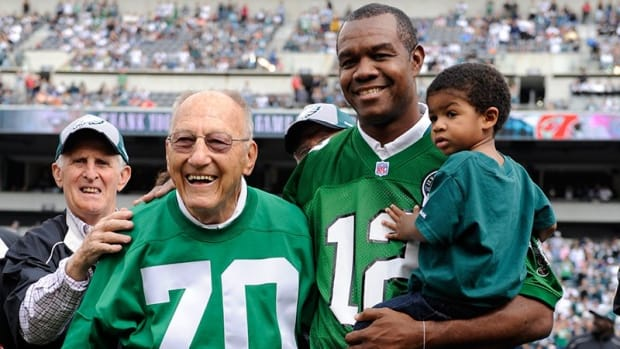 Al Wistert (No. 70) with Randall Cunningham in 2009 induction into Eagles Honor Roll