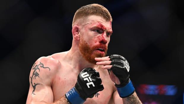 Closeup of a bloody Paul Felder at UFC 242