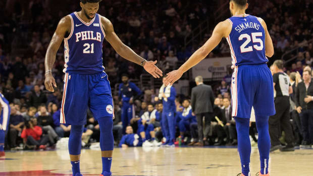Ben Simmons and Joel Embiid slapping hands