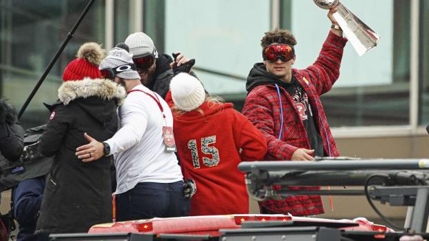 Feb 5, 2020; Kansas City, Missouri, USA; Kansas City Chiefs quarterback Patrick Mahomes (15) hoists the Lombardi Trophy during the Super Bowl LIV championship parade in Kansas City, Missouri. Mandatory Credit: Jay Biggerstaff-USA TODAY Sports