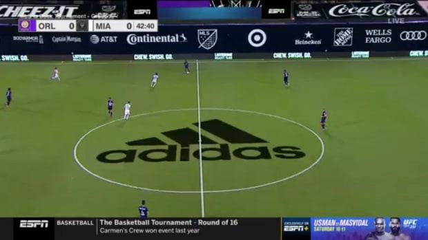 Screenshot of ESPN MLS broadcast showing ads on screen