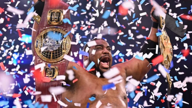 WWE's Keith Lee celebrates in the ring after winning the NXT Championship