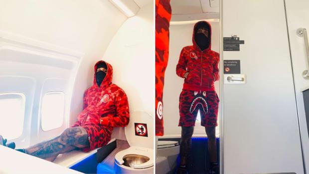 Blazers' Gary Trent Jr. poses in airplane bathroom
