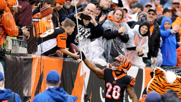 Cincinnati Bengals running back Joe Mixon (28) hands the ball to a fan after scoring a touchdown in the fourth quarter during an NFL Week 17 game against the Cleveland Browns, Sunday, Dec. 29, 2019, at Paul Brown Stadium in Cincinnati. Cincinnati Bengals won 33-23. Cleveland Browns At Cincinnati Bengals Football 12 29 2019
