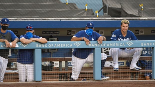 Jul 6, 2020; Los Angeles, California, United States; Los Angeles Dodgers right fielder Joc Pederson (far right) watches the action from the dugout during an intrasquad game at Dodger Stadium. Mandatory Credit: Robert Hanashiro-USA TODAY Sports