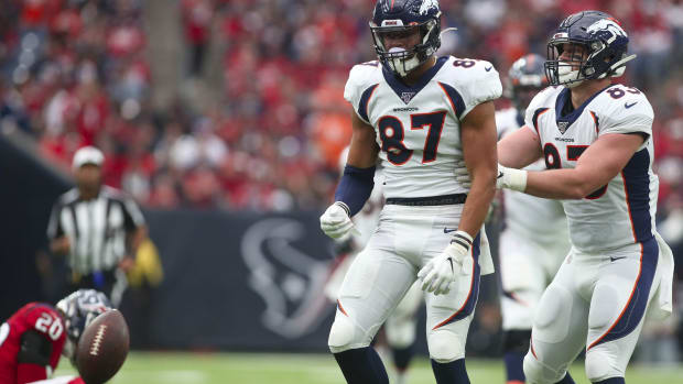 Denver Broncos tight end Noah Fant (87) flips the ball after a reception during the second quarter against the Houston Texans at NRG Stadium.