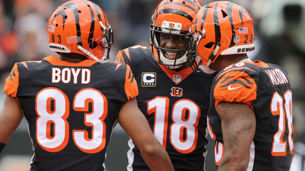 Cincinnati Bengals wide receiver A.J. Green (18), Cincinnati Bengals wide receiver Tyler Boyd (83) and Cincinnati Bengals running back Joe Mixon (28) celebrate a touchdown in the second quarter during a NFL football game between the Tampa Bay Buccaneer and the Cincinnati Bengals, Sunday, Oct. 28, 2018, at Paul Brown Stadium in Cincinnati. Cincinnati Bengals Vs Tampa Bay Buccaneers Oct 28
