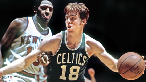 Former Boston Celtics center Dave Cowens drives to the basket as a rookie while being defended by New Yourk Knicks legend Willis Reed.