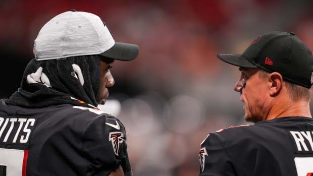 Aug 29, 2021; Atlanta, Georgia, USA; Atlanta Falcons tight end Kyle Pitts (8) and quarterback Matt Ryan (2) talk on the sideline at Mercedes-Benz Stadium.