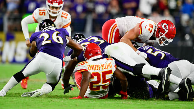 Sep 19, 2021; Baltimore, Maryland, USA; Kansas City Chiefs running back Clyde Edwards-Helaire (25) fumbles as Baltimore Ravens defender se recovers during the fourth quarter at M&T Bank Stadium. Mandatory Credit: Tommy Gilligan-USA TODAY Sports