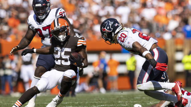 Sep 19, 2021; Cleveland, Ohio, USA; Cleveland Browns running back Demetric Felton (25) runs the ball as Houston Texans strong safety Justin Reid (20) moves in to tackle him during the third quarter at FirstEnergy Stadium. Mandatory Credit: Scott Galvin-USA TODAY Sports