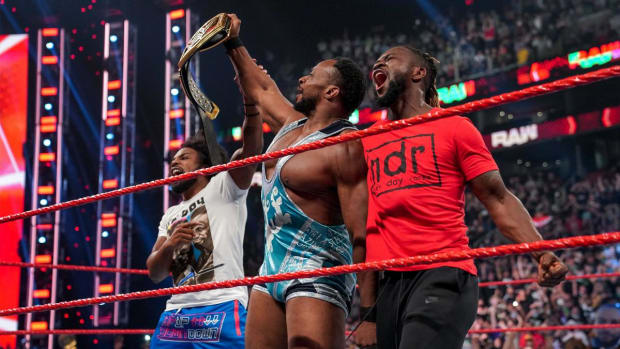 Big E, Xavier Woods and Kofi Kingston celebrate in the ring after E's championship victory