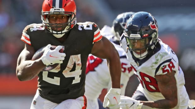 Cleveland Browns running back Nick Chubb (24) rushes for a touchdown ahead of Houston Texans outside linebacker Christian Kirksey (58) during the second half of an NFL football game, Sunday, Sept. 19, 2021, in Cleveland, Ohio. [Jeff Lange/Beacon Journal]  Browns 18