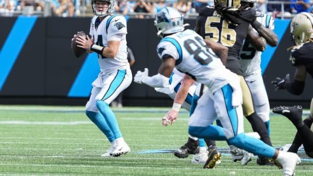 Sep 19, 2021; Charlotte, North Carolina, USA; Carolina Panthers quarterback Sam Darnold (14) drops back to pass looking at wide receiver Terrace Marshall Jr. (88) during the second half at Bank of America Stadium. Mandatory Credit: Jim Dedmon-USA TODAY Sports