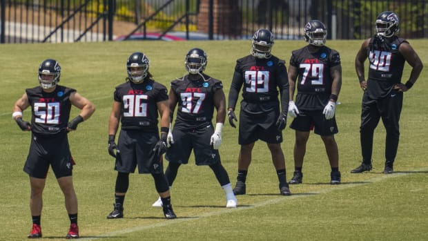 May 25, 2021; Flowery Branch, GA, USA; Atlanta Falcons defensive linemen including defensive tackle Grady Jarrett (97) warm up during Falcons OTA at the Falcons Training Complex.