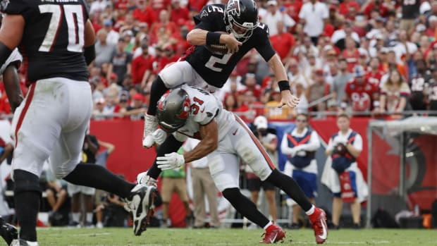 Sep 19, 2021; Tampa, Florida, USA; Atlanta Falcons quarterback Matt Ryan (2) runs the ball in for a 2-point conversion against the Tampa Bay Buccaneers during the second half at Raymond James Stadium.