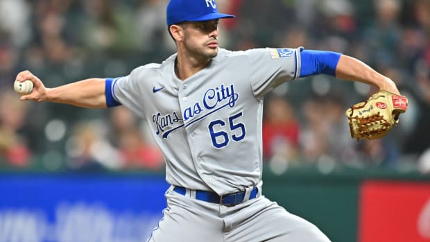 Sep 21, 2021; Cleveland, Ohio, USA; Kansas City Royals relief pitcher Dylan Coleman (65) throws a pitch during the seventh inning against the Cleveland Indians at Progressive Field. Mandatory Credit: Ken Blaze-USA TODAY Sports