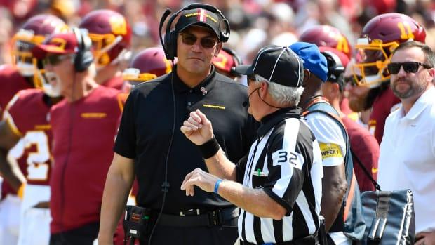 Washington coach Ron Rivera talks with a referee on the sideline