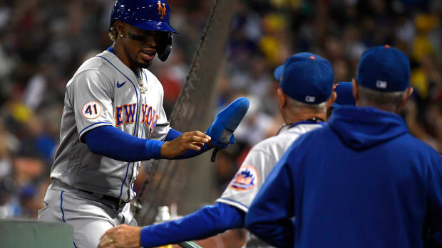 Sep 21, 2021; Boston, Massachusetts, USA; New York Mets shortstop Francisco Lindor (12) is greeted in the dugout after scoring a run against the Boston Red Sox during the fourth inning at Fenway Park.