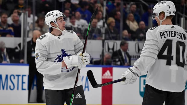 Quinn Hughes and Elias Pettersson