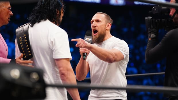 Bryan Danielson thrusts his finger in Kenny Omega's chest during a promo