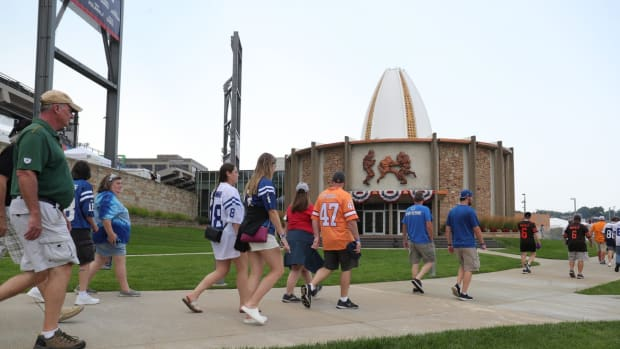 Fans walk to the HOF museum before the Pro Football Hall of Fame Enshrinement ceremony Sunday, Aug. 8, 2021 at Tom Benson Hall of Fame Stadium in Canton, Ohio.