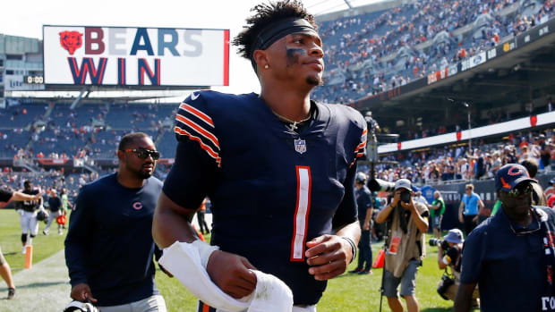 Sep 19, 2021; Chicago, Illinois, USA; Chicago Bears quarterback Justin Fields (1) runs off the field after their 20-17 win over the Cincinnati Bengals at Soldier Field. Mandatory Credit: Jon Durr-USA TODAY Sports