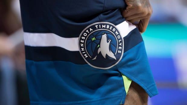 Timberwolves logo on shorts.