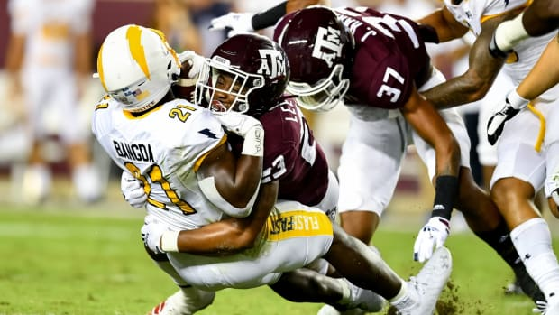 Sep 4, 2021; College Station, Texas, USA; Texas A&M Aggies linebacker Tarian Lee Jr. (23) tackles Kent State Golden Flashes running back Joachim Bangda (21) during the fourth quarter at Kyle Field. Mandatory Credit: Maria Lysaker-USA TODAY Sports