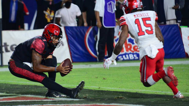 Sep 18, 2021; Carson, California, USA; San Diego State Aztecs quarterback Lucas Johnson (7) catches a pass in th end zone for two point conversion against Utah Utes cornerback Malone Mataele (15) during overtime at Dignity Health Sports Park. Mandatory Credit: Gary A. Vasquez-USA TODAY Sports