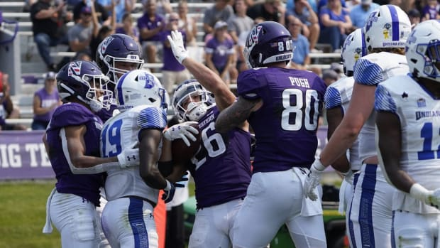 Sep 11, 2021; Evanston, Illinois, USA; Northwestern Wildcats running back Evan Hull (26) celebrates a touchdown against the Indiana State Sycamores during the second half at Ryan Field. Mandatory Credit: David Banks-USA TODAY Sports