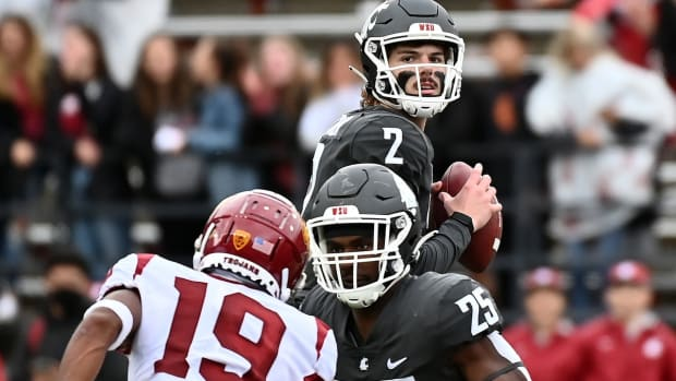 Sep 18, 2021; Pullman, Washington, USA; Washington State Cougars quarterback Cammon Cooper (2) drops back for a pass against the USC Trojans in the second half at Gesa Field at Martin Stadium. The Trojans won 45-14. Mandatory Credit: James Snook-USA TODAY Sports