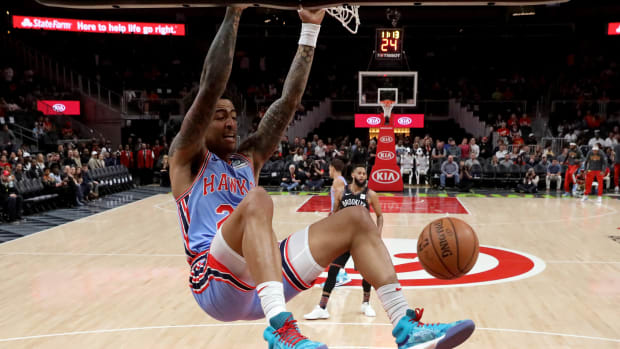 Atlanta Hawks forward John Collins (20) dunks in the first quarter against the Brooklyn Nets at State Farm Arena.