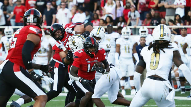 Sep 18, 2021; Lubbock, Texas, USA; Texas Tech Red Raiders running back Xavier White (14) runs the ball against the Florida International Panthers in the first half at Jones AT&T Stadium. Mandatory Credit: Michael C. Johnson-USA TODAY Sports