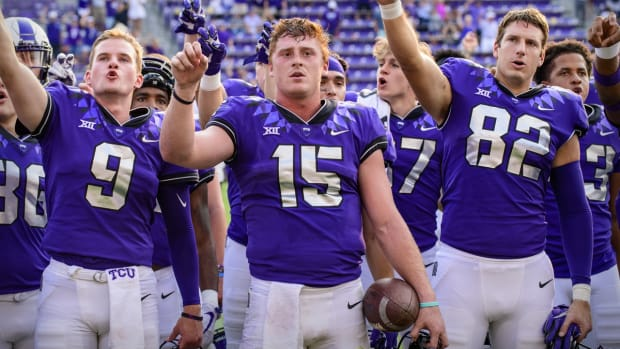 Sep 11, 2021; Fort Worth, Texas, USA; TCU Horned Frogs quarterback Luke Pardee (9) and quarterback Max Duggan (15) and tight end Mitchell Hansen (82) sing the school alma mater after the win over the California Golden Bears at Amon G. Carter Stadium. Mandatory Credit: Jerome Miron-USA TODAY Sports