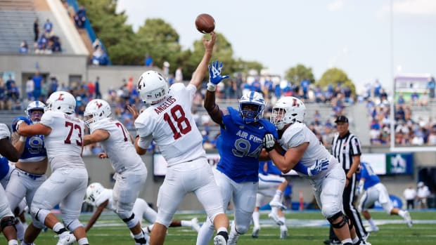 Sep 4, 2021; Colorado Springs, Colorado, USA; Lafayette Leopards quarterback Aaron Angelos (18) passes under pressure from Air Force Falcons defensive tackle Jordan Jackson (94) and offensive lineman Beau Bedard (75) defends in the third quarter at Falcon Stadium. Mandatory Credit: Isaiah J. Downing-USA TODAY Sports