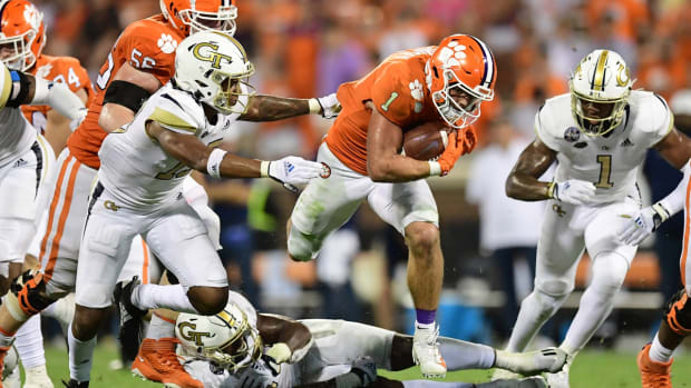 Sep 18, 2021; Clemson, South Carolina, USA; Clemson Tigers running back Will Shipley (1) carries the ball against the Georgia Tech Yellow Jackets during the second half at Memorial Stadium. Mandatory Credit: Adam Hagy-USA TODAY Sports