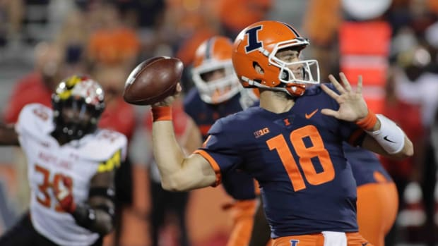 Sep 17, 2021; Champaign, Illinois, USA; Illinois Fighting Illini quarterback Brandon Peters (18) looks to pass during the first quarter of Friday  s game with the Maryland Terrapins at Memorial Stadium. Mandatory Credit: Ron Johnson-USA TODAY Sports