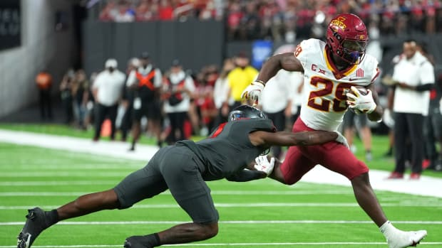 Sep 18, 2021; Paradise, Nevada, USA; Iowa State Cyclones running back Breece Hall (28) is hit by UNLV Rebels defensive back Nohl Williams (2) during a game at Allegiant Stadium. Mandatory Credit: Stephen R. Sylvanie-USA TODAY Sports
